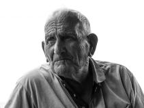 Un pescatore. Vulcano 2014 - Canon PowerShot G1 X, 60,4mm, 1/60 ƒ/8 ISO 100
