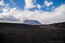The skyline of the Herðubreið Volcano accompanies the traveller for most of the trip. Nikon D810, 24 mm (24-120.0 mm ƒ/4) 1/200 sec ƒ/7.1 ISO 64
