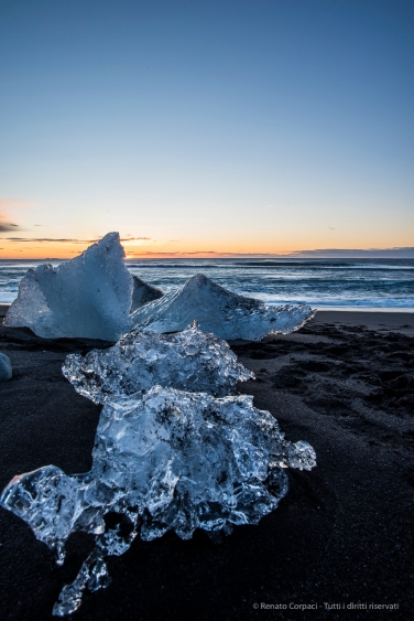 """The iced blocks let go with the tide out of the Jökusárlón, get pushed ashore by the waves and get scattered all over the beach. D810 20 mm (20.0 mm ƒ/1.8 1/5"""" ƒ/13 ISO 64 – ND 6H Lee filter"""