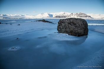 """The sun melts the snow which, with the lowering of the temperature, turns itself into ice surrounding the rocks with glass. D810 24 mm (24.0 mm ƒ/1.4) 1/160"""" ƒ/7.1 ISO 64"""
