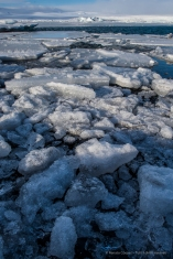 """The ice covering the Jökulsárlón lagoon cracks into smaller pieces that get carried out by the flood tide entering the lagoon. Nikon D810 24 mm (24.0 mm ƒ/1.4) 1/160"""" ƒ/11 ISO 64"""