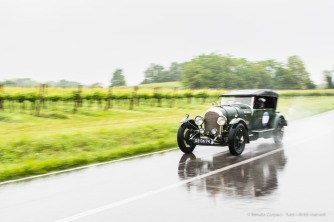 "Alan and Hans Hulsbergen on a 1923 BENTLEY 3 LITRE with the number ""1"". Nikon D810, 24 mm (24.0mm ƒ/1.4) ) 1/80"" ƒ/2.5 ISO 64"