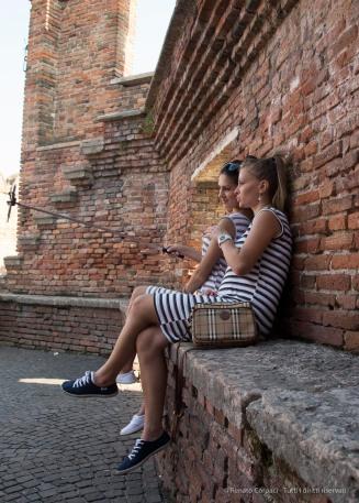 "Two girls from Moldova selfie themselves above the Castelvecchio Bridge. Nikon D810 24 mm (24-120.0 mm ƒ/4) 1/200"" ƒ/6.3 ISO 400"