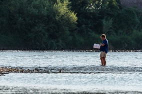 "A gentleman rehersing his part standing with his feet in the streem of the river Adige. Verona, August 2016. Nikon D750 400 mm (80-400.0 mm ƒ/4.5-5.6) 1/640"" ƒ/8 ISO 320"
