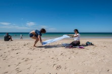 "Setting down a beach towel can be a real tricky operation. Nikon D810, 24 mm (24,0 mm ƒ/1.4) 1/250"" ƒ/8 ISO 64"