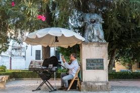"""A street musician in Ronda, Plaza Maria Auxiliadora. Nikon D810, 46 mm (24-120.0 mm ƒ/4) 1/100"""" ƒ/7.1 ISO 1600"""