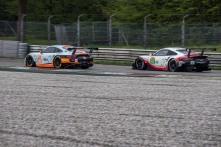 """Amateur and pro Porsche 911 RSR exiting Lesmo 1. Nikon D750, 200 mm (80-400.0 mm ƒ/4.5-5.6) 1/320"""" ƒ/8 ISO 500"""