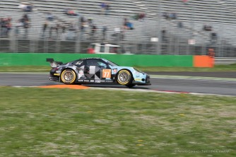 "Porsche 911 RSR (991) takes off on the kerb at the First Chicane. Nikon D810, 105 mm (105.0 mm ƒ/2.8) 1/100"" ƒ/10 ISO 64"